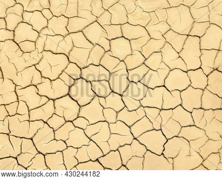 Cracked Soil Of Barren Land. Wasteland Texture Close Up