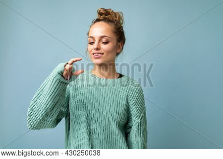 Portrait Of Young Happy Positive Beautiful Blonde Woman With Sincere Emotions Wearing Casual Blue Pu