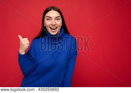 Portrait Of Beautiful Fascinating Emotional Positive Joyful Happpy Female Promoter Pointing To The S