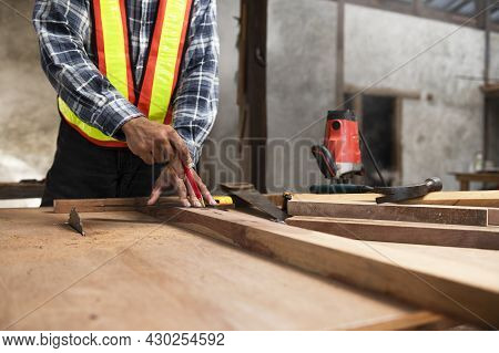 Asian Carpenters Work On Woodworking Machines In A Carpentry Shop. Young Man Working In A Carpentry