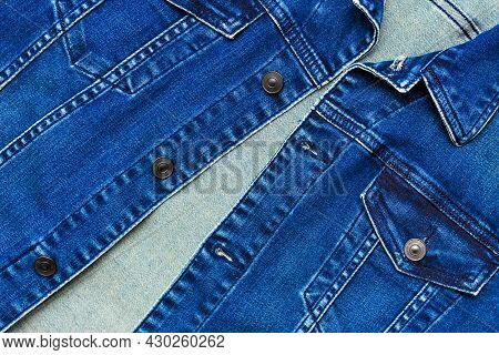 Close Up View Of Denim Jacket With Buttons And Pockets. Blue Denim Jacket, Top View. Men's Denim Jac