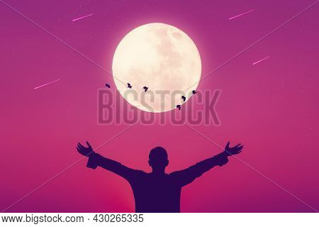 Man Raise Hand Up On Sunset Sky And Birds Fly With Full Moon Abstract Background. Copy Space Of Free