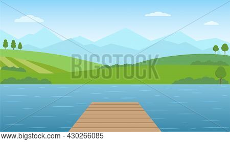 Empty Wooden Pier At Lake. Panoramic Summer Landscape. Rural Scenery With Lake, Green Hills And Moun
