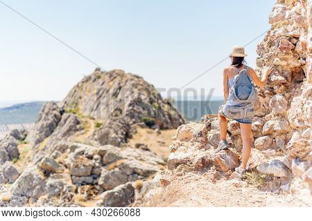 Woman Contemplating The Landscape From The Top Of A Hill