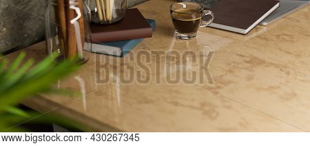 Working Desk With Copy Space On Marble Table With Brown Tint