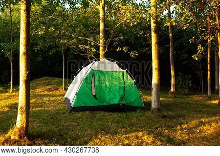 Green Color Tourist Tent In The Forest, Sunrise At The Tourist Camp. Active Summer Holidays, Family