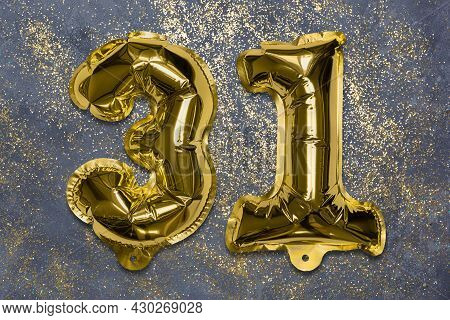 The Number Of The Balloon Made Of Golden Foil, The Number Thirty-one On A Gray Background With Sequi