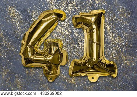 The Number Of The Balloon Made Of Golden Foil, The Number Forty-one On A Gray Background With Sequin