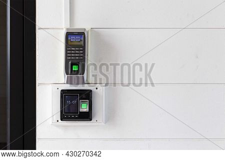 Close-up Finger Scanner And Enter The Code Before Entering The Building