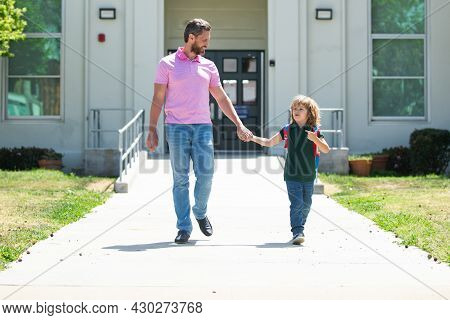 School Boy Going To School With Father. Parent Taking Child To School. Pupil Of Primary School Go St
