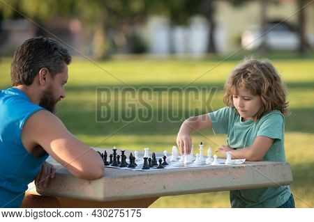 Father And Son Playing Chess. Fathers Day, Love Family, Parenthood, Childhood Concept. Games And Act