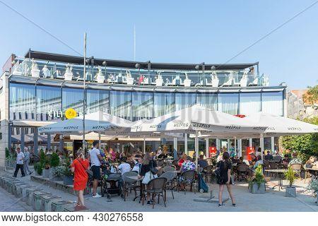 Restaurant Terrace Is Reopen. People Enjoy A Coffee Or A Drink On An Outdoor Terrace. People Enjoy S
