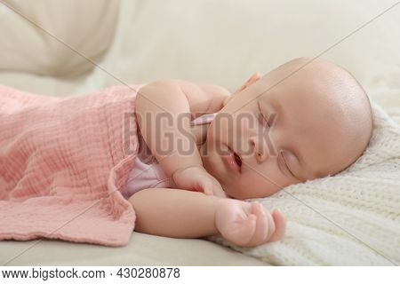 Cute Little Baby Sleeping On Blanket At Home