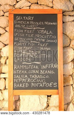 Chalkboard Menu Black Color, Message Or Advertising. Blackboard Is Standing Near The Restaurant In S