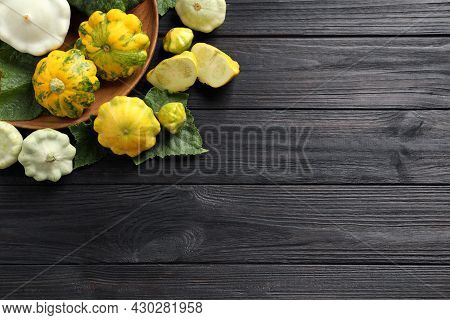 Fresh Ripe Pattypan Squashes With Leaves On Black Wooden Table, Flat Lay. Space For Text