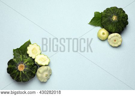 Fresh Ripe Pattypan Squashes With Leaves On Light Background, Flat Lay. Space For Text