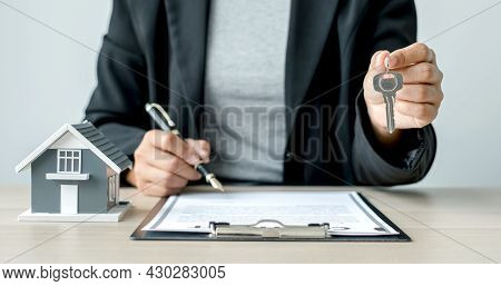 Agents Working In Real Estate Investment Hold The Key Ready Home Insurance Signing Contracts In Acco
