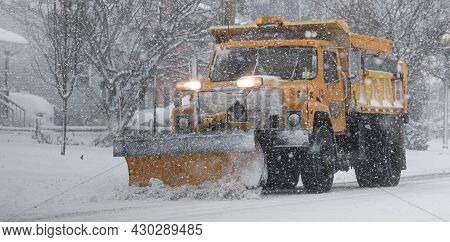Babylon, New York, Usa - 1 February 2021: Close Up Of A Yellow Truck With A Yellow Snowplow Plowing