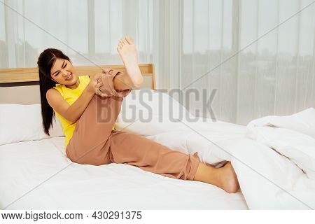 Concept Health Care : Young Woman Suddenly Had Muscle Pain In Her Thighs From Cramps While She Slept