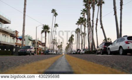 Defocused Road With Palm Trees In California, Oceanside Tropical Beach Resort, Usa. Waterfront Stree