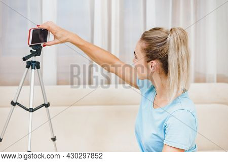 Pretty Happy Young Girl In Front Of Smartphone On Tripod And Communicating Online, Communication Thr
