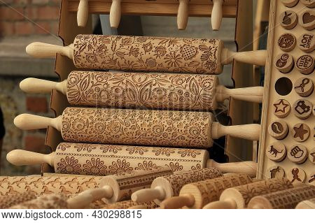 A Display Of Wooden Rolling Pins With Various Designs.