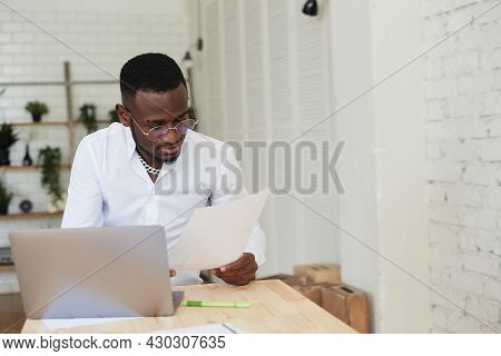 Happy Focused African American Man Making A Video Call With Customer Partners. Young Black Man Uses