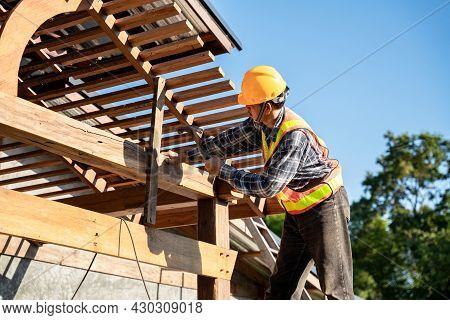 Roofer, A Carpenter Working On Roof Structure On Construction Site