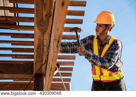Asian Roofer Carpenter Working On Roof Structure On Construction Site, Roofer
