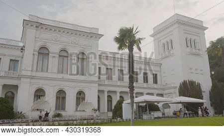 Facade Of Livadia Palace In Crimea. Action. Beautiful Facade Of White Old Building With Columns In E