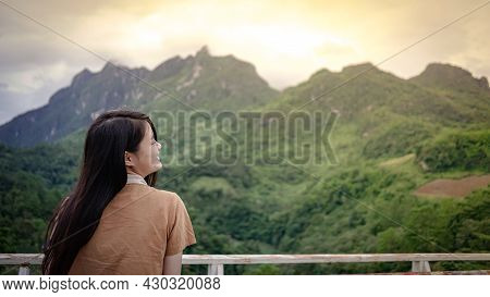 Hipster Happy Tourist Young Girl Smiling And Enjoy Feeling To The Sunset On Peak Of Foggy Mountain A