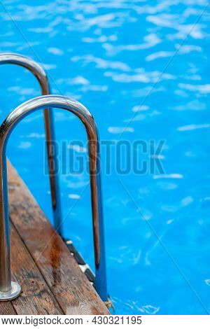 Ladder Stainless Handrails For Descent Into Swimming Pool. Swimming Pool With Handrail . Ladder Of A