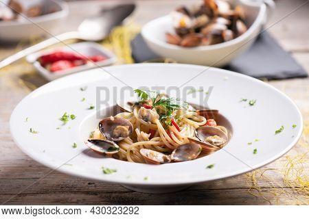 Italian Food. Spaghetti With Clams Juicy, Garlic. Close Up