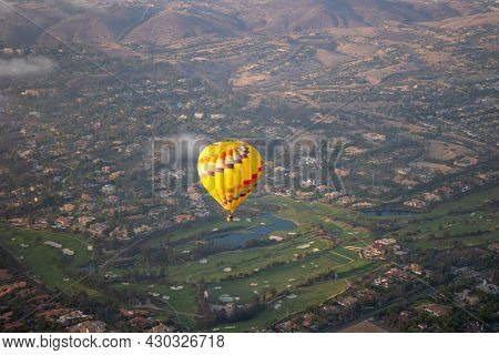 Colorful Hot Air Balloons In The Sky With San Diego Valley, California. Usa
