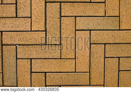 Close-up View Of Yellow Block Pavior Driveway. Seamless Texture Of Street Tiles. Pattern Of Sidewalk