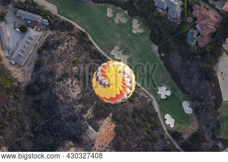 Top View Of Colorful Hot Air Balloons On The Sky Over Golf Court, In San Diego, California. Usa