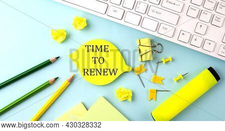Text Sign Showing Time To Renew With Office Tools And Keyboard On Blue Background