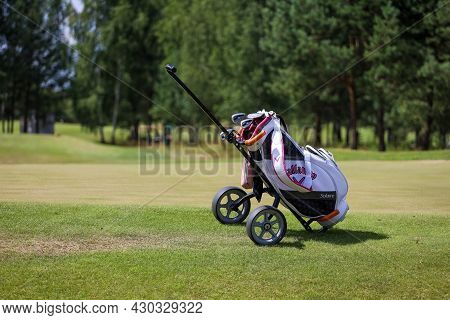 Minsk. Belarus - 25.07.2021 - Push-pull Golf Carts On The Field. Green Grass, Trees. High Quality Ph