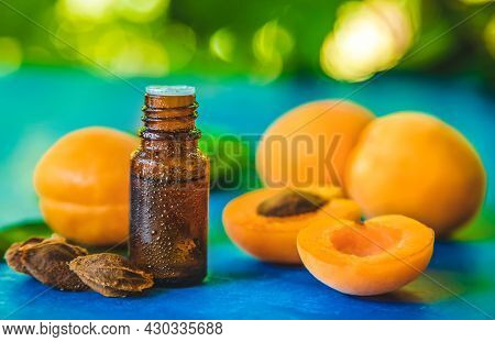Apricot Kernel Oil In A Bottle. Selective Focus. Nature.