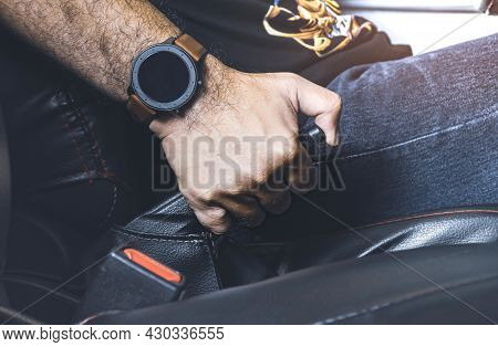 Car Driver Pulling Handbrake Lever In The Car On The Parking