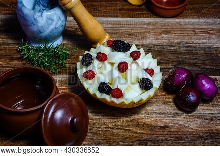 Food Figurine On Wooden Background. Works Of Art From Food. Beautiful Food Pattern. Food Patterns On