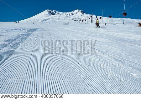 Snow Velvet Of A Ski Piste. Snow Groomer Tracks On Ski Slope. Morning Groomed Snow. Ski Piste Prepar