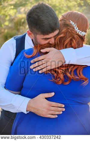 Turkish Man And His Beloved Caucasian Plus Size Red Headed Woman Embracing. Mixed Race Couple Hugs A