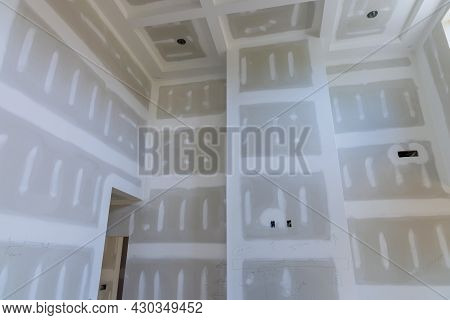 Finishing Putty On Drywall With A Spatula The House On Ceiling And Wall