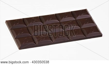 Chocolate Bar, Confectionery Product, Isolated On A White Background. A Popular Aromatic Sweet Delic