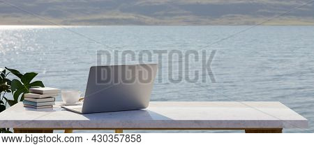 Backside Of Laptop Mockup On White Marble Table With Copy Space, Lake Landscape In The Background