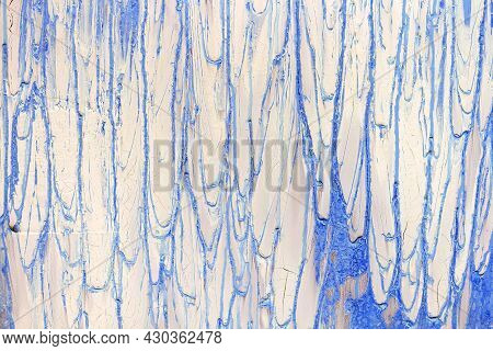 Soft Focus Texture And Pattern Of An Old White Concrete Wall With Blue Streaks Of Paint. Background