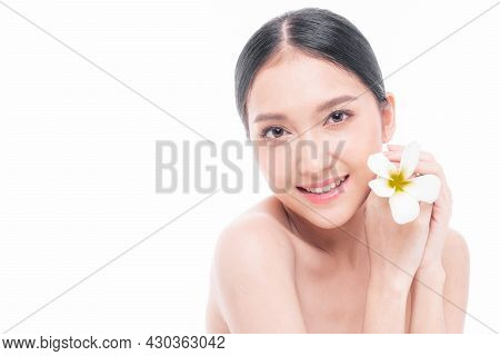 Beautiful Young Asian Woman  With Clean Skin ,fresh Skin Holding  White Flower Tropical Leaf In Hand