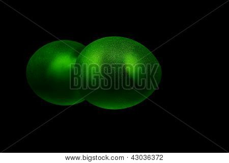 Green egg isolated on black