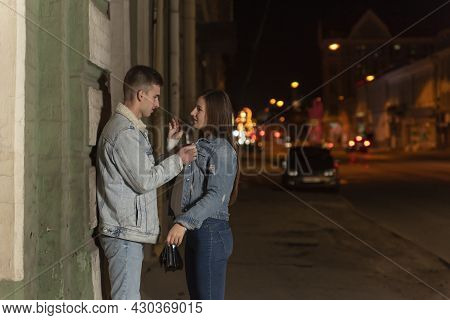 Guy And Girl Argue Late At Night In The City. Guy Is Eager To Hug His Girlfriend. Evening Date. Roma